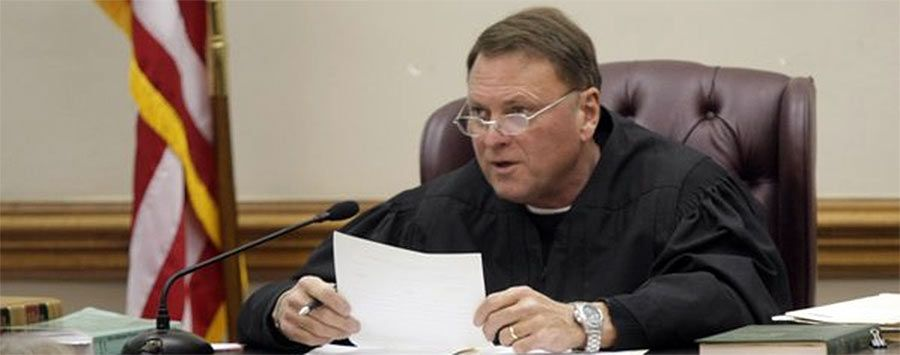 Photo of Arkansas judge rules same-sex marriage legal