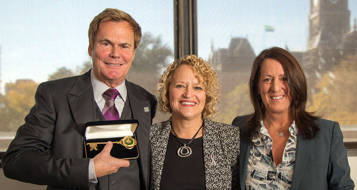 Photo of Biskupski presents Kate Kendall, Bruce Bastian with Keys to the City