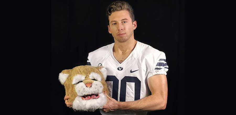 Photo of BYU's football mascot Cosmo unmasked