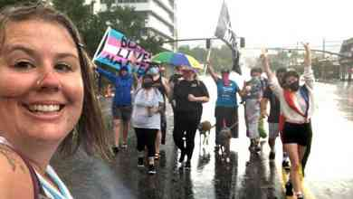 Photo of Small group braves a downpour for their own Utah Pride Parade